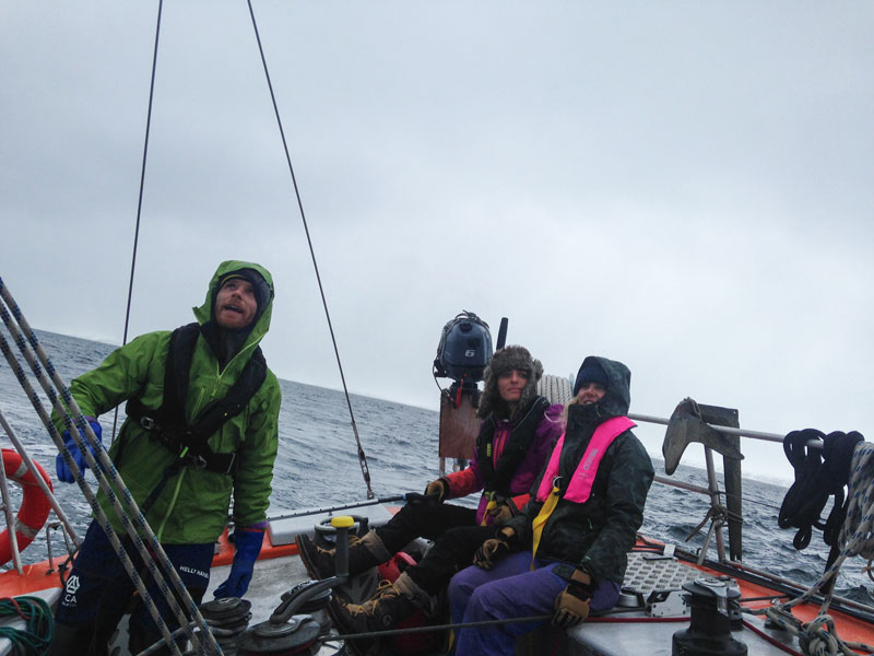 Nayla, Hadley and Ben prepare to put up sail. Photo: Rachel Eden Reich