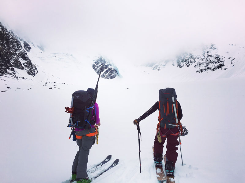 Jessica and Rachel soak in the terrain as the clouds move in. Photo: Nayla Tawa