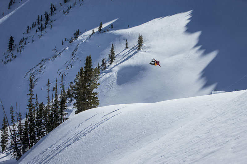 Cam FitzPatrick absolutely sending it in the Jackson Hole backcountry. Photo Credit: Scott Serfas/Red Bull