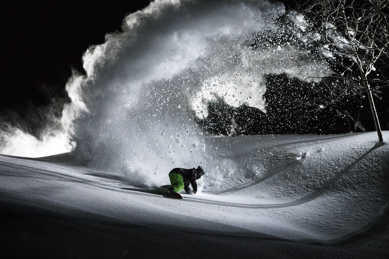 Mark Landvik owns the night like batman in Hakuba, Japan. Photo Credit: Scott Serfas/Red Bull