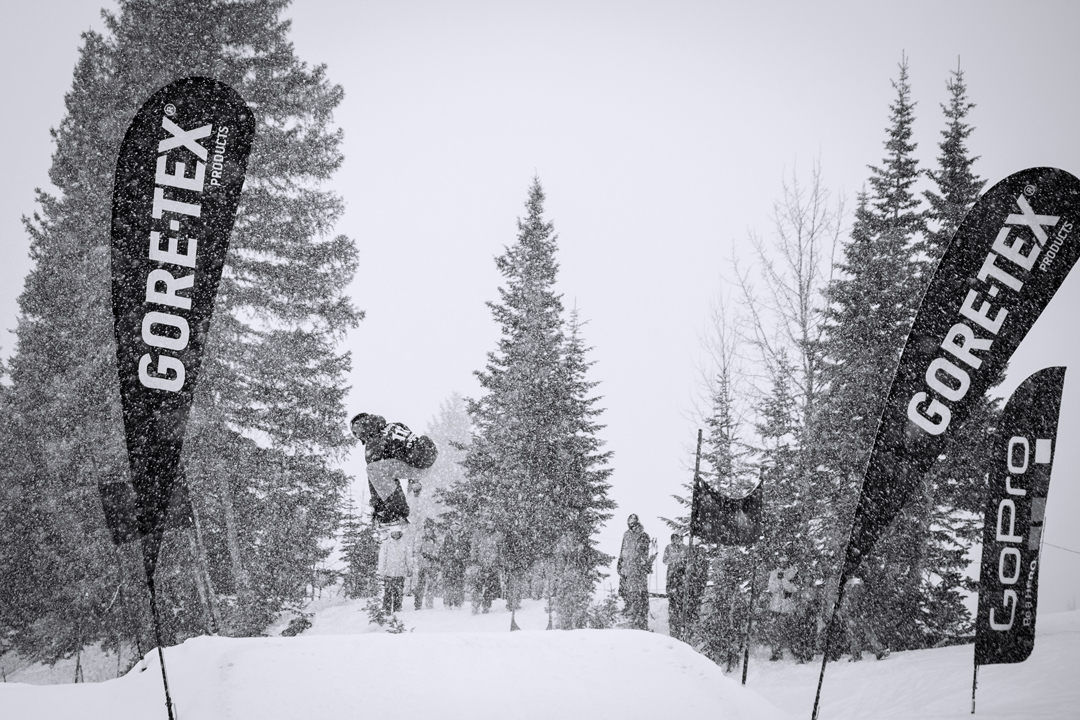 Snowboarding. 18-19 JHSM. A Dick's Ditch competitor catches some air mid run amid a blizzard. Photo: Jackson Hole Mountain Resort.