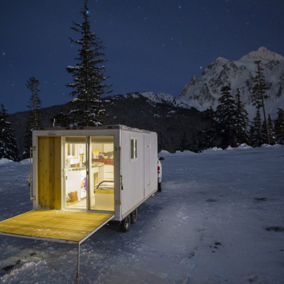 Snowboarding. 18-19 JHSM. Ben Gavelda's home on wheels glows on a frosty night. Photo: Ben Gavelda.