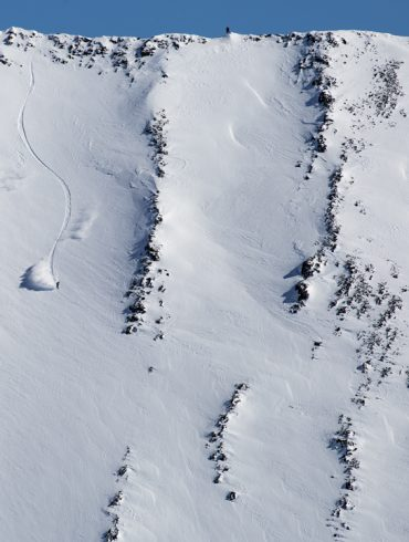 Snowboarding. 18-19 JHSM. Rider Robin Van Gyn riding in the Crazy Mountains of Montana. Photo: Ben Gavelda.