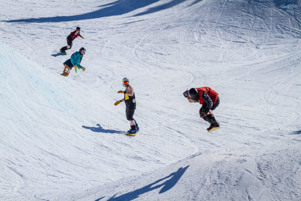 Riders (from left to right) Aaron Lebowitz, Jennifer Williams, Keaton Britt, and Josh Wolfman flying through a party lap.
