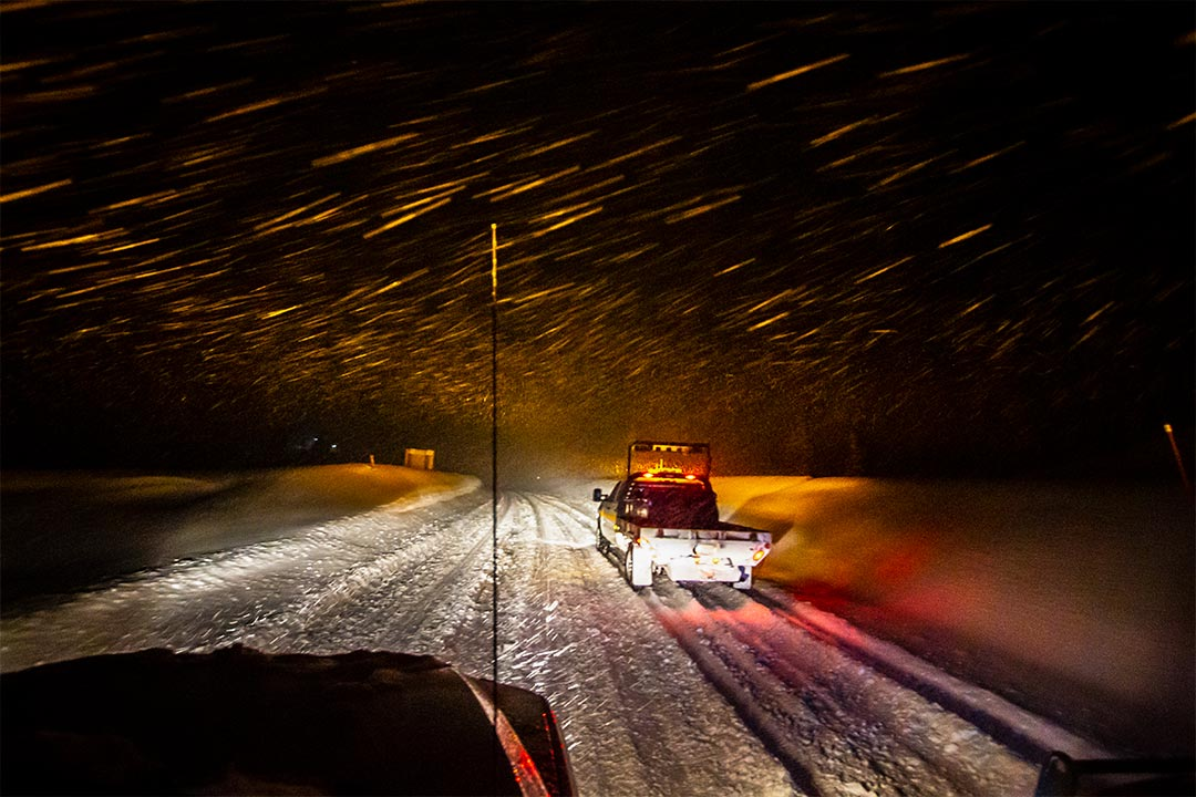 Clearing snow off of Teton Pass at night.