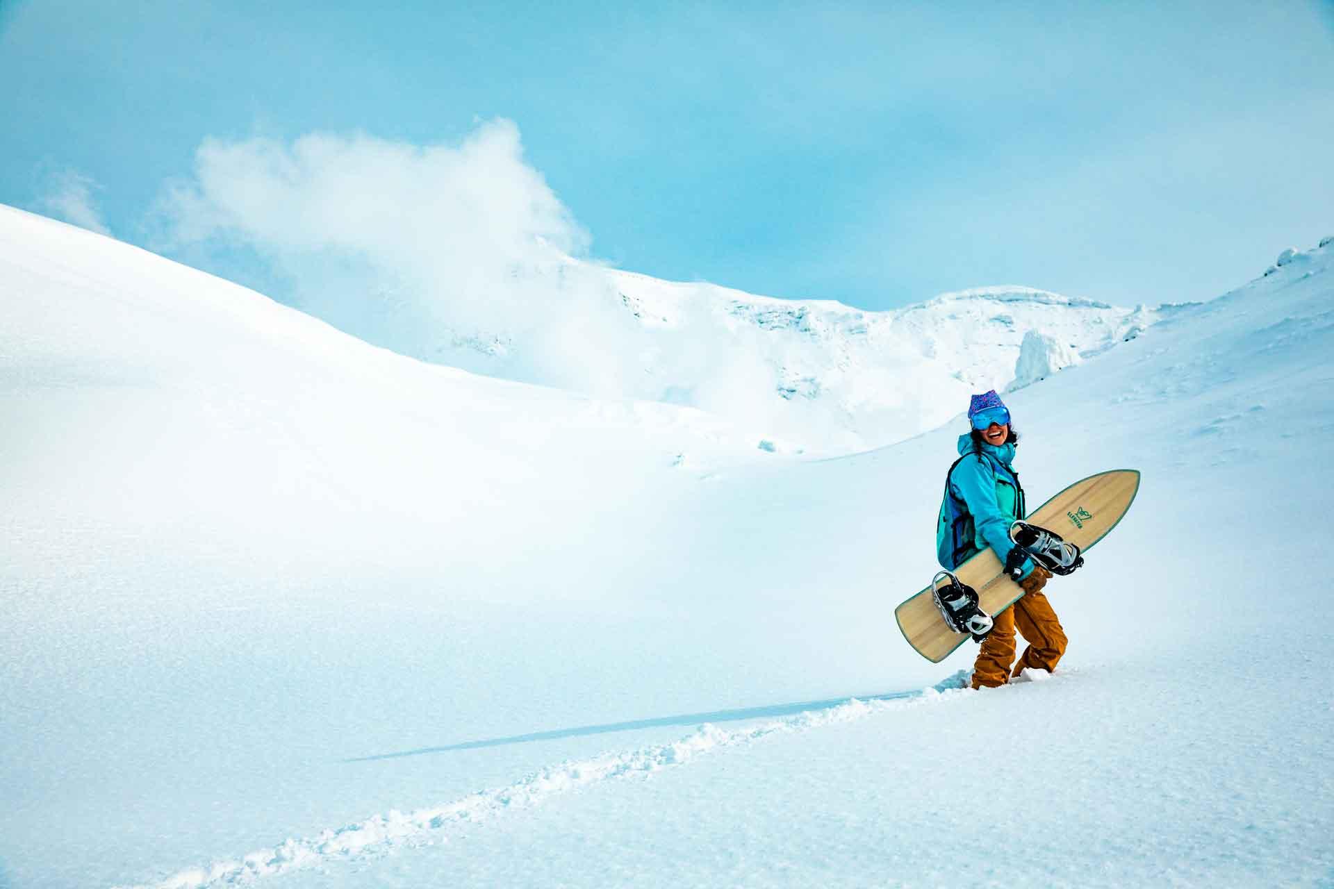 Shawna Paoli posing with the 4'6 Minni Driver snowboard.